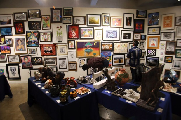 Guests examine 330 art pieces Wednesday, May 16, at The Press-Enterprise 56th Annual Riverside County High School Art Show at the Riverside Art Museum. (Photo by James Carbone, contributing photographer)
