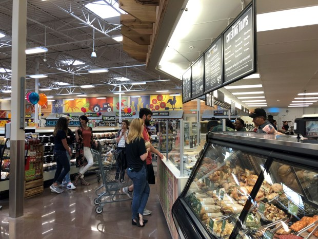 Sprouts is remodeling three stores in the next two months, adding a salad bar, made-to-order sushi rolls and poke bowls and hot entrees and sides. The grocery store's $4 sandwich specials and fan-favorite bulk bins are staying. (Photo courtesy of Sprouts)