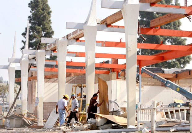 A former Alpha Beta grocery store is gutted by demolishion workers at the Uptown Whittier site north of Bailey Street, between Milton and Comstock avenues Nov. 16, 2007. (SGVN/Staff photo by Leo Jarzomb/SWCITY)