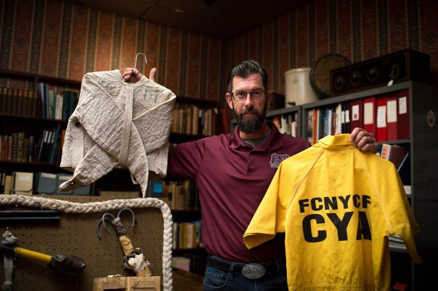 Sean Thomsen, vice pres. of the Whittier Museum, shows on Monday, May 7, 2018 a straight jacket and a California Youth Authority jumper collected from the now-closed Fred C. Nelles Youth Correctional Facility which is scheduled for demolition. These artifacts eventually will be turned into an exhibit about Nelles at the museum. (Photo by Sarah Reingewirtz, Pasadena Star-News/SCNG)