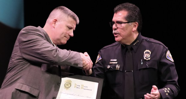 Detective Donald Goodman is honored by Long Beach Police Chief Robert Luna at the 50th Annual Long Beach Police Foundation Police Award Ceremonies at the Carpenter Center. Photo: Tom Bray, SCNG