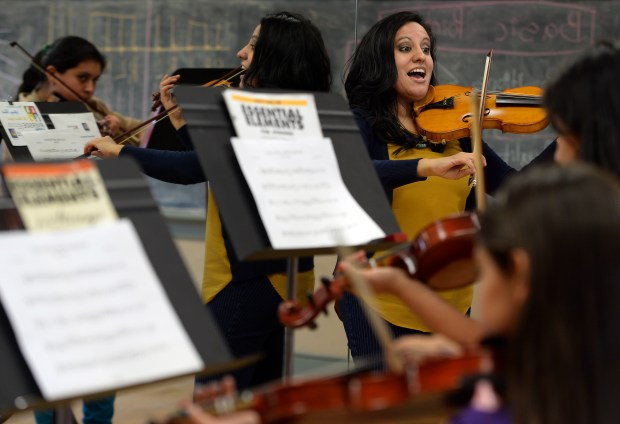Violin instructor Noemy Wheeler, of Riverside, leads her students during class as part of the Harmony Project at the Riverside Arts Academy at the Cesar E. Chavez Community Center in Riverside, CA., Thursday, May 17, 2018. (Staff photo by Jennifer Cappuccio Maher, The Press-Enterprise/SCNG)