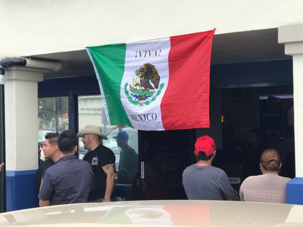 A banner honoring Mexico hangs outside the Mariscos El Capitan restaurant at 1106 S. Bristol St. in Santa Ana on Sunday. Police on Sunday closed a portion of Bristol as fans of Mexico's soccer team celebrated Mexico's victory over Germany in the World Cup. Photo by Nathaniel Percy/Southern California News Group