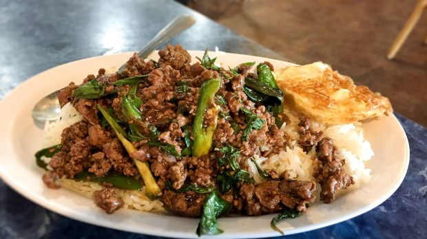 Beef pad kra pow with a fried egg served over rice at Thai and Laos Market in Anaheim. (Photo by Brad A. Johnson, Orange County Register/SCNG)