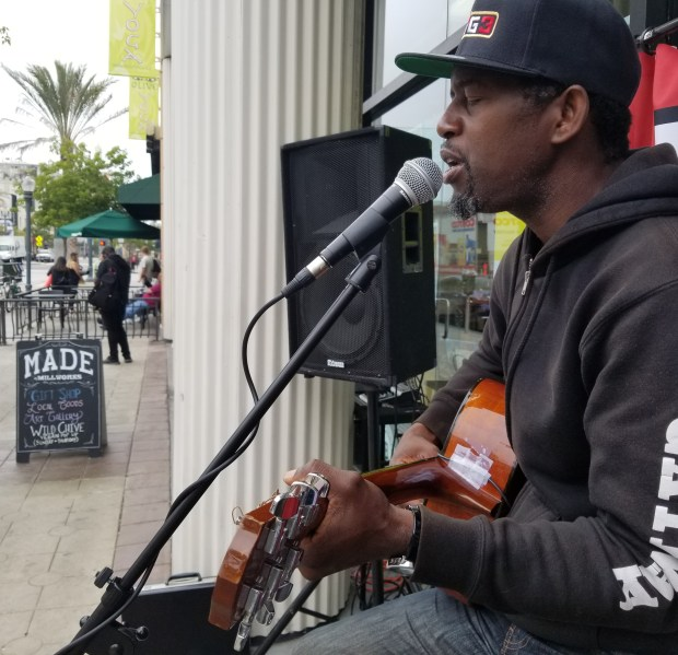 Chad Bishop performs in front of MADE by Millworks on Pine Avenue in Downtown Long Beach on Thursday morning as part of Make Music Day. Photo: Tom Bray, SCNG