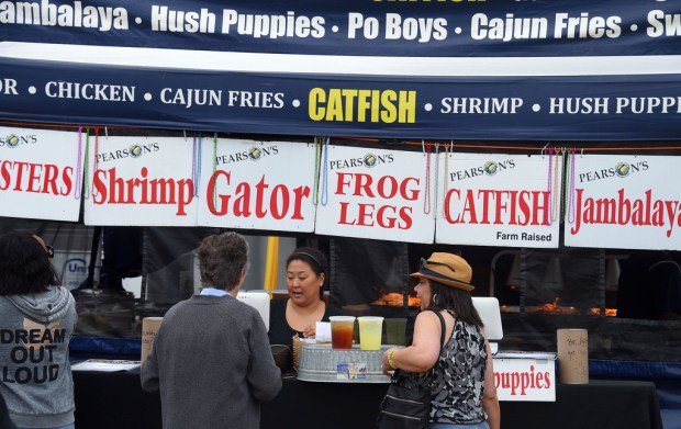 People line up for Cajun food during the 32nd annual Long Beach Bayou Festival next to the Queen Mary on Saturday, June 23, 2018. The two-day event kicked off Saturday and will conclude Sunday. The event features two live music stages with dancing, Cajun food and plenty of activities for children. (Photo by Scott Varley, Contributing Photographer)