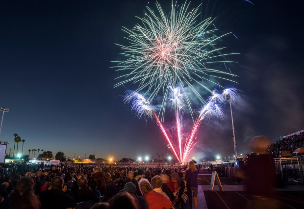 People watch fireworks during the City of Orange's annual Third of July Celebration at Fred Kelly Stadium. (Register file photo)