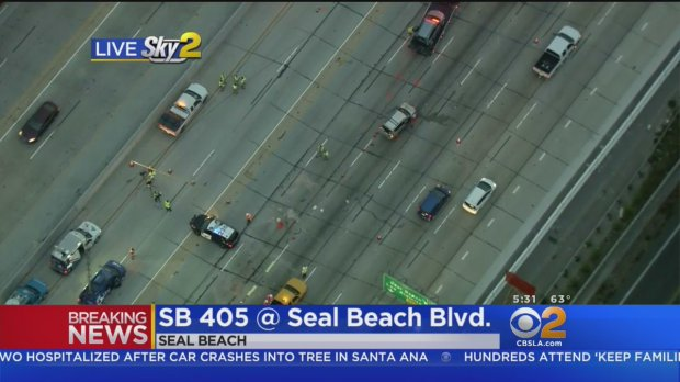 KCBS-KCAL's helicopter is over the scene early Friday, June 15, 2018, of a crash on the southbound 405 Freeway in Seal Beach where two people died at the scene and three others -- including a child -- were hospitalized. (Image from KCBS-KCAL video)