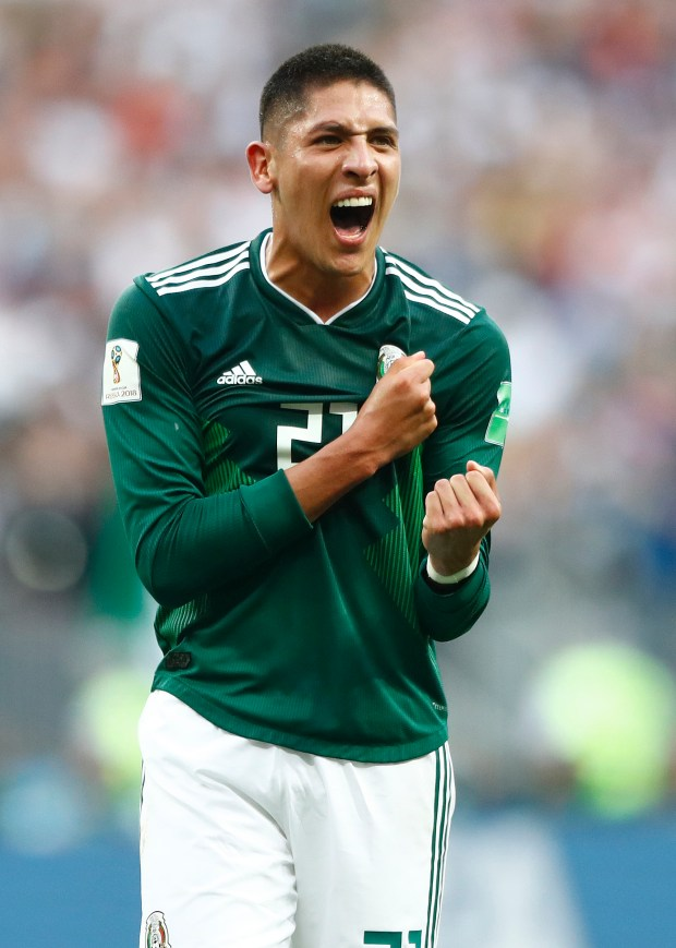 Mexico's Edson Alvarez celebrates after his team won the group F match between Germany and Mexico at the 2018 soccer World Cup in the Luzhniki Stadium in Moscow, Russia, Sunday, June 17, 2018. Mexico won 1-0.  (AP Photo/Matthias Schrader)