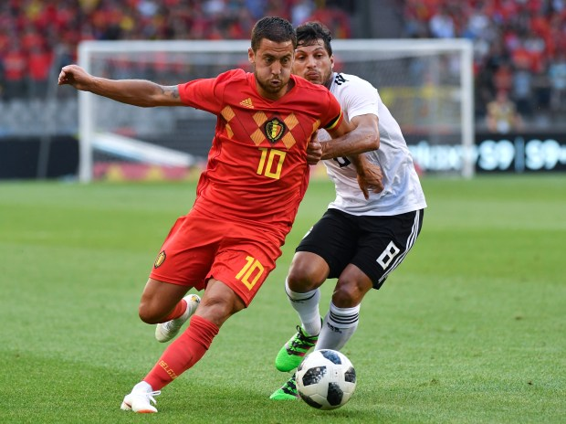 Belgium's Eden Hazard, left, is pursued by Egypt's Tarek Hamed during a friendly soccer match between Belgium and Egypt at the King Baudouin stadium in Brussels, Wednesday, June 6, 2018. (AP Photo/Geert Vanden Wijngaert)