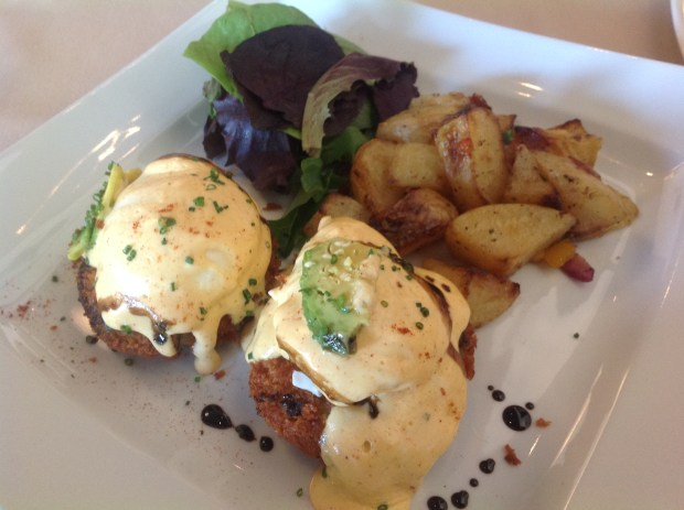 Tutu Mangia's Crab Benedict consisted of two Maryland lump crab cakes, poached farm-fresh eggs, sliced avocado, Hollandaise sauce and smoked paprika accompanied by breakfast potatoes. (Photo by Dorene Cohen)