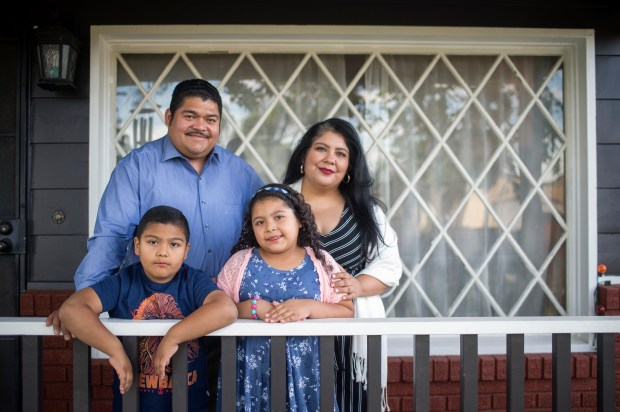 Pastor Noe Carias with his wife Victoria, son Abraham , 6-years old and daughter Nylah, 7-year old, at his home in North Hollywood on Thursday, June 14, 2018. Pastor Carias was detained by Immigration and Customs Enforcement (ICE) after a routine check-in last year and was detained for two months at the Adelanto Detention Facility before being released. (Photo by Hans Gutknecht, Los Angeles Daily News/SCNG)