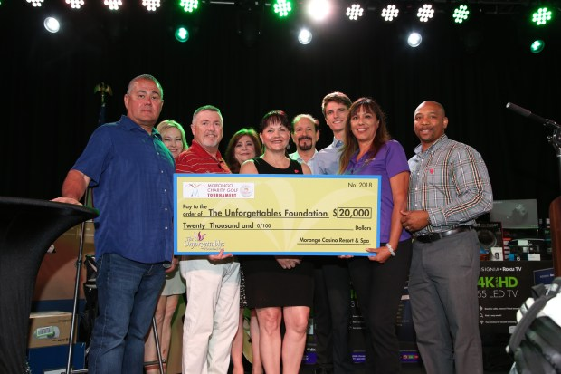 Morongo Tribal Council Member Damon Sandoval, left, presents a $20,000 check to officials with The Unforgettables Foundation.(Courtesy photo)