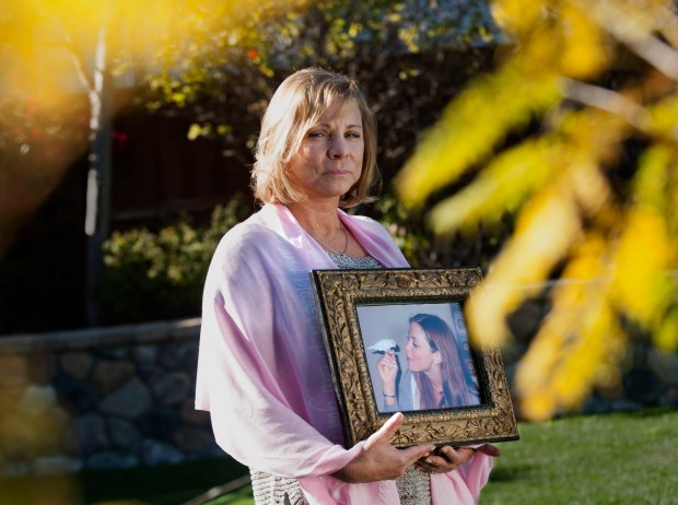 In this 2015 file photo, Deborah Ziegler with a photo of her daughter Brittany Maynard who was very public about choosing to end her life after being diagnosed with terminal cancer. (File photo by ANA VENEGAS, ORANGE COUNTY REGISTER /SCNG)