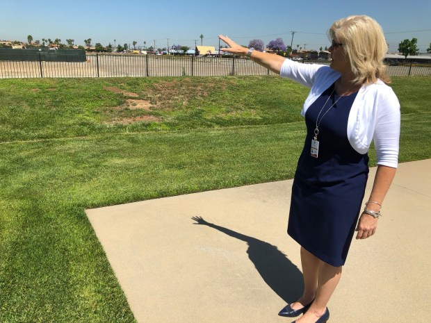 Patti Solano, Moreno Valley director of parks and community services, points out the location for a planned amphitheater behind the city's Conference and Recreation Center. City officials are considering building a 600-seat amphitheater to host community events. (Photo by David Downey, staff)