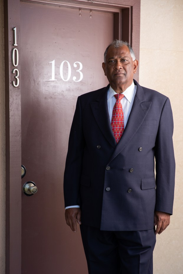 Dr. Carlos Beharie stands next to the front door of his former office which is now used by another physician at the Merced Medical Square in West Covina, Calif. on Tuesday June 26, 2018. (Photo by Raul Romero Jr, Contributing Photographer)