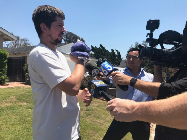Frank Simon, is shown here telling reporters how he tried to fight thesuspect who was assaulting his mother. He heard her screams and intervened. He was also struck by the suspect and injured his hand. (Photo by Alma Fausto, Orange County Register/SCNG)