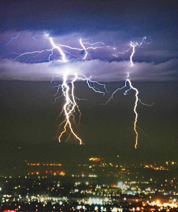 Rain begins in parts of Southern California — lightning illuminates the sky in some areas