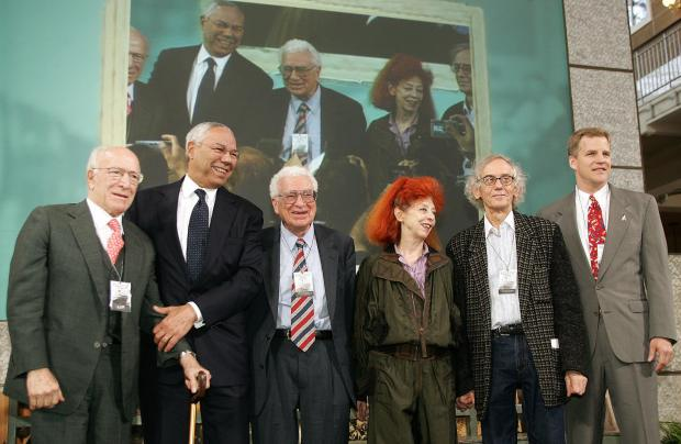 Recipients of the Ellis Island Family Heritage Award (L to R) Robert Mondavi, left, Colin Powell, Murray Gell-Mann, Jeanne-Claude and Christo and Scott Parazynski pose for a photograph on April 19, 2005 in the Great Hall at Ellis Island in New York. Gell-Mann, who won the Nobel Prize for physics in 1969, died Friday, May 24, 2019, at age 89. (Photo by Don Emmert/AFP/Getty Images)