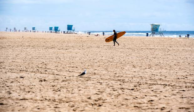 Expert warns surfers and outdoor enthusiasts of added risks for coronavirus spread