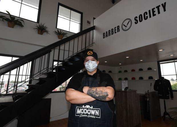 Some Southern California barbers, salon owners defy state health orders and open indoors