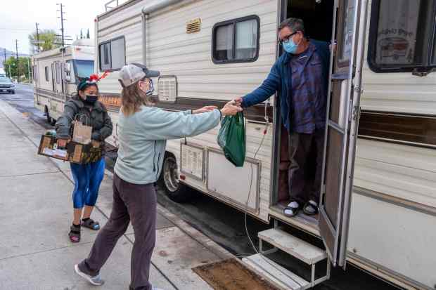 West San Fernando Valley residents bring holiday aid and cheer to unhoused neighbors, friends
