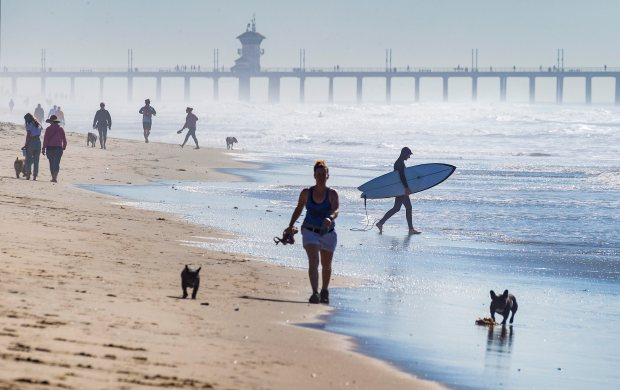 Warm 80 degree weather, strong winds and more surf on the way