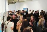 crowd mingling in an art gallery