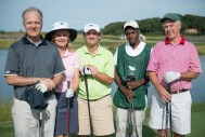 Five individuals stand in golf caps and holding golf clubs smiling at the 2013 Howard F. Treiber Memorial Golf Outing