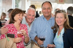 Four attendees laugh and smile for a picture with their drinks at the 2013 Howard F. Treiber Memorial Golf Outing