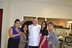 four women posed with man in chef coat