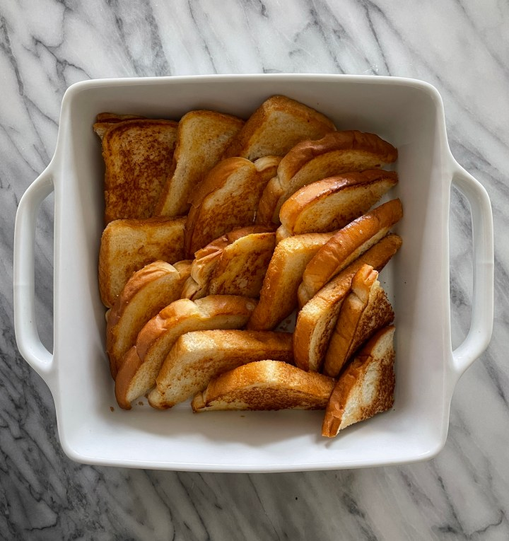 cut th bread diagonally and layer in your pan