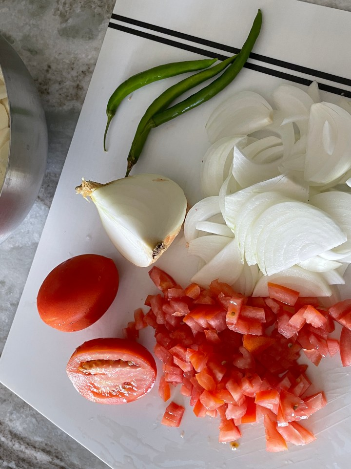 onions and tomatoes make the base of the masala. Soak the potatoes in water