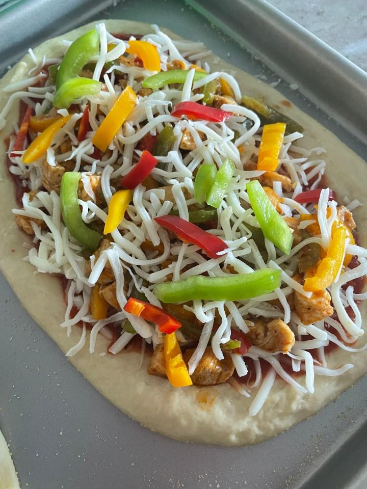chicken fajita pizza ready to be baked