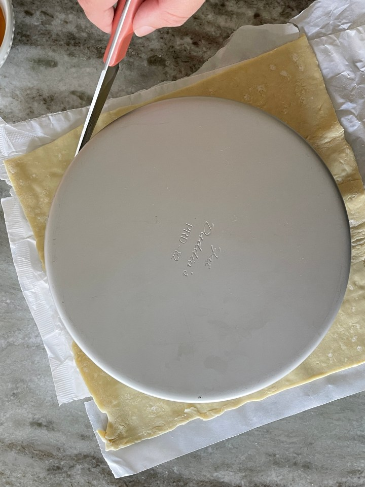 Cut the puff pastry into an 8-9 inch round for crostata base