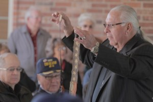 A Quapaw tribal elder receives items, including a commissioning pennant, from the former fleet ocean tug of the same name Nov. 7 in Quapaw, Okla. (Photo by Luke Anderson)