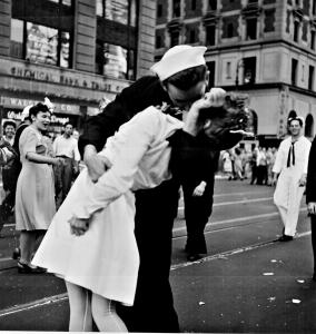 QM1 George Mendosa plants a kiss on Greta Zimmer Friedman in Times Square on Aug. 14, 1945, after the announcement that Japan had surrended. (Photo by  Lt. Victor H. Jorgensen)