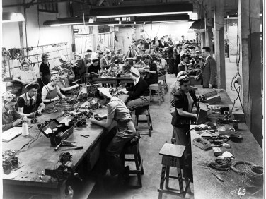 Women soldering and assembling cables for airplanes