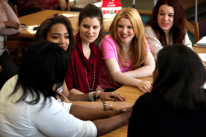group of diverse young women in conversation