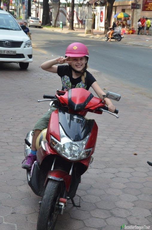 kid on motorbike tour in saigon