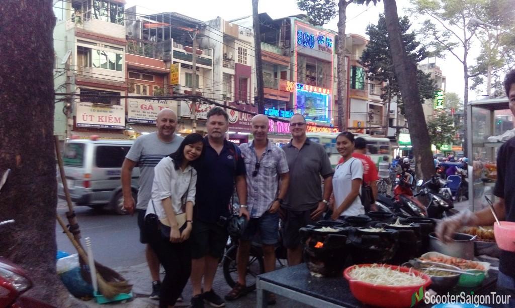 saigon motorbike tour eating banh xeo