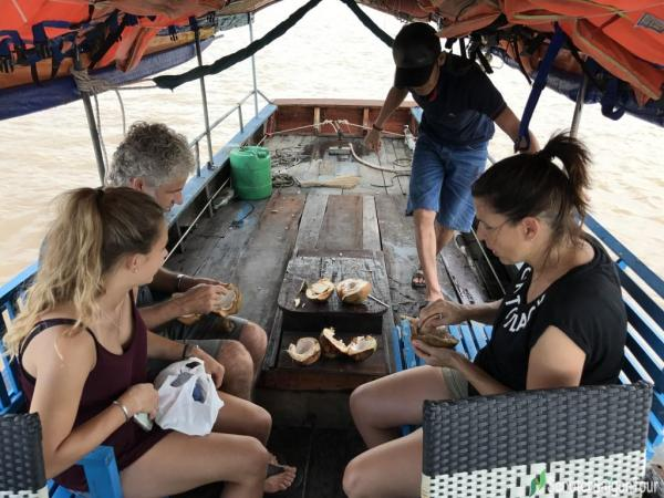 Eating Coconut Meat In Mekong Delta