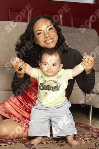 Baroness Oona King celebrates with son Tullio ( aged 9 months ) and husband Tiberio at their home in London.