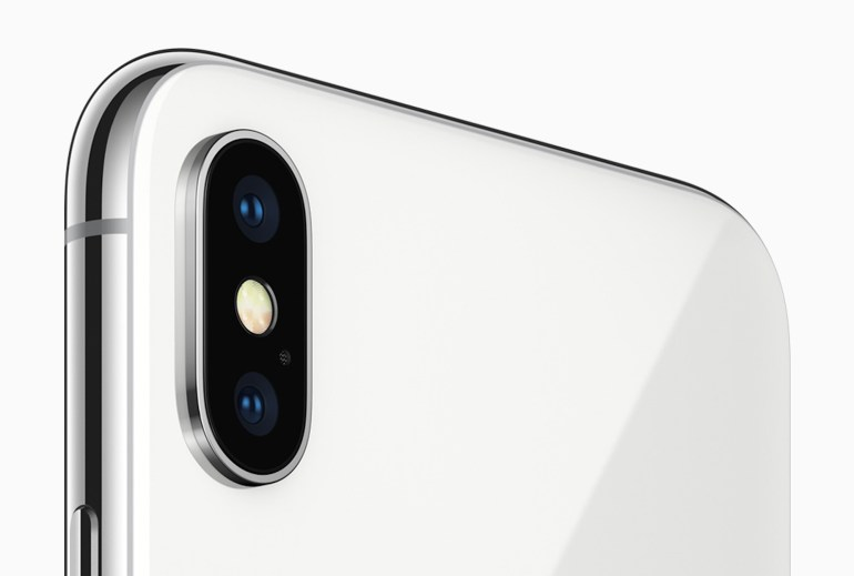 iPhone X features the 7MP TrueDepth camera and a redesigned 12MP rear camera with dual OIS.