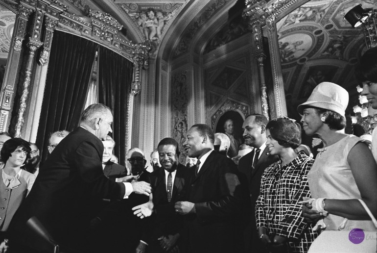 President Lyndon Johnson shakes hands with civil rights activists, including Dr. Martin Luther King Jr., after signing the Voting Rights Act of 1965. Image courtesy the LBJ Presidential Library.