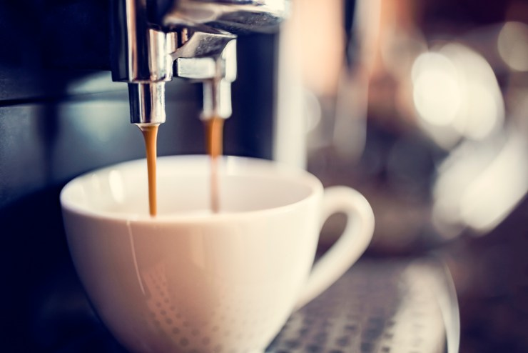 Using an espresso machine to make coffee for coffee lovers.