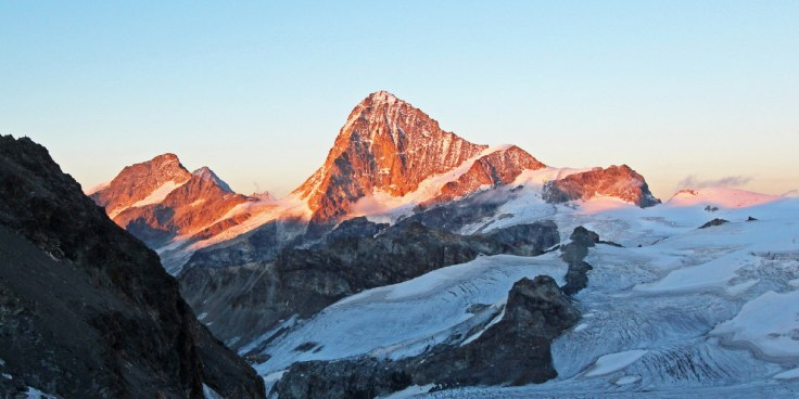 Photo of evening sunlight on the Dent Blanche, seen from the Cabane de Bertol. The Grand Cornier on the left.