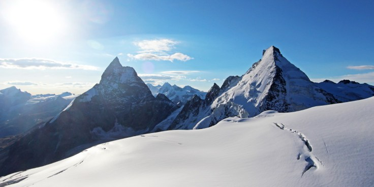 Photo of the Matterhorn from an usual angle with the Dent d'Herens on the right. Taken from the summit of the Tete Blanche the Zmutt ridge is on the left of the Matterhorn and the Cresta del Leone (or Italian ridge) on the right