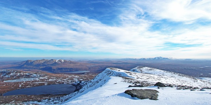 Photo of a winter view of Ben Loyal & Ben Klibreck from Ben Hope over the huge expanse of Sutherland's open flow country