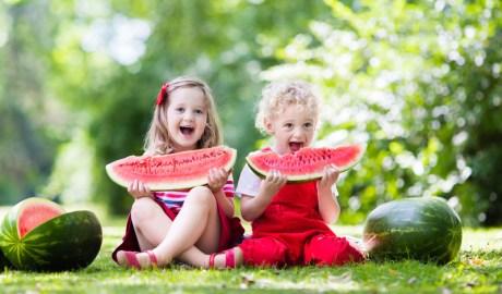 Kids eating watermelon